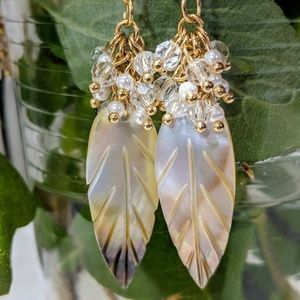 Leaf shell earrings topped with pearls